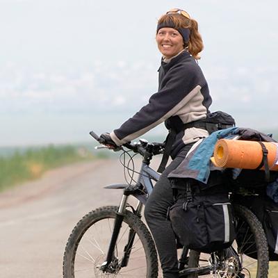 Woman_on_touring_bike_www.yha.co.nz.jpg
